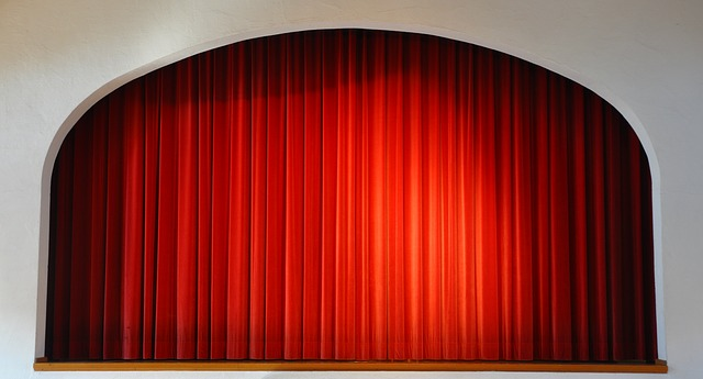 Why are stage curtains usually red